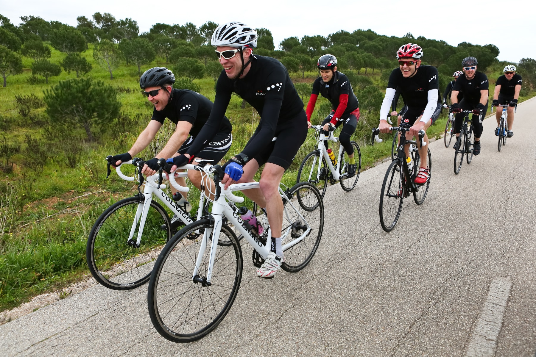 Group of cyclists on Colnago bikes